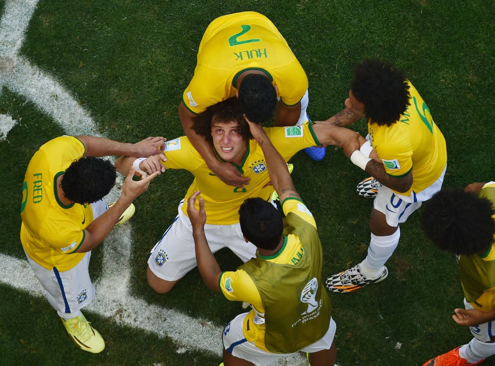 Brazil players celebrate after beating Chile on penalties to make it through to the quarter-finals of the World Cup