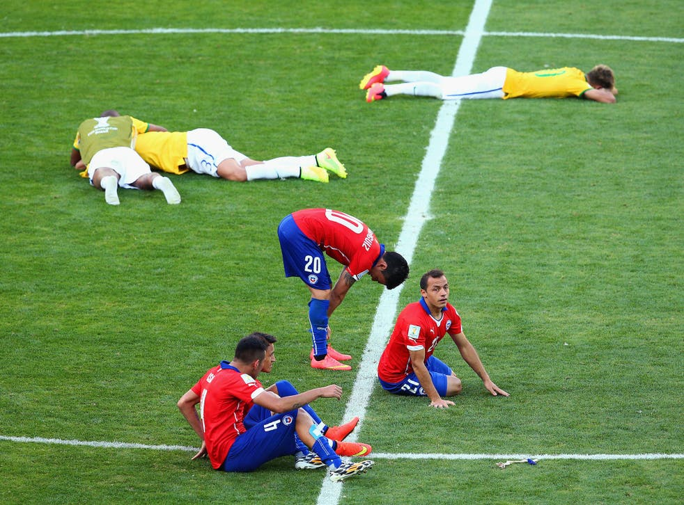 Chile and Brazil players react after seeing Gonzalo Jara miss the crucial penalty