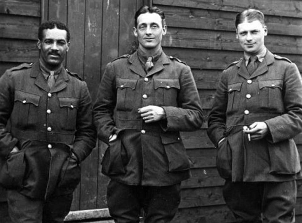 Walter Tull, left, Britain's first black Army officer, in a photograph handed down to his great-nephew Edward Finlayson