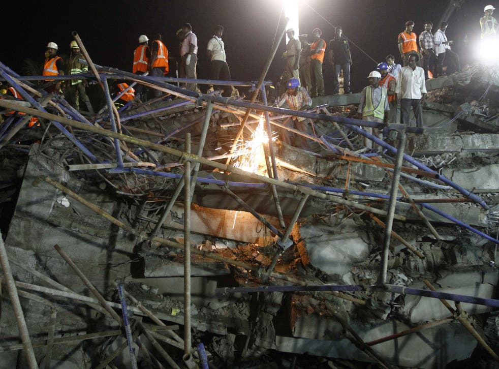 Rescue workers conduct a search operation for survivors at the site of a collapsed 11-storey building that was under construction on the outskirts of the southern Indian city of Chennai