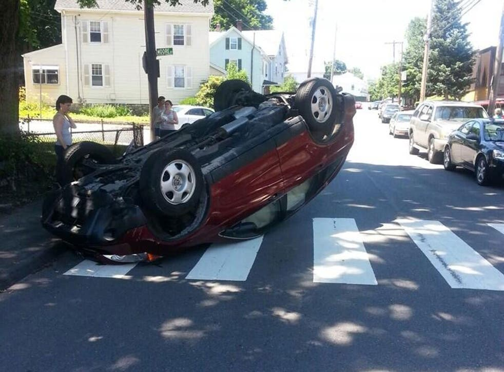 Police tweeted this picture of the car post-flip. Those involved only suffered 'very minor injuries'