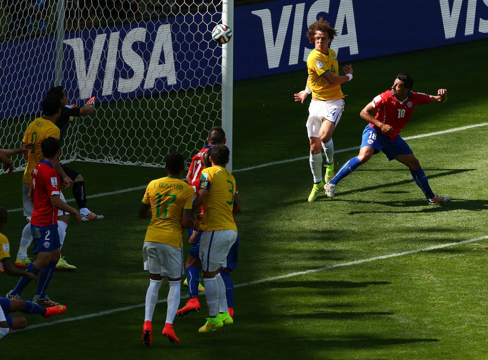 David Luiz and Gonzalo Jara both went for the ball before it went in the back of the net for Brazil