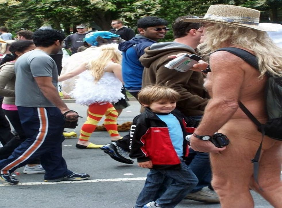 A picture of a naked man horrifying a child has gone viral after it was thought to be from Glastonbury