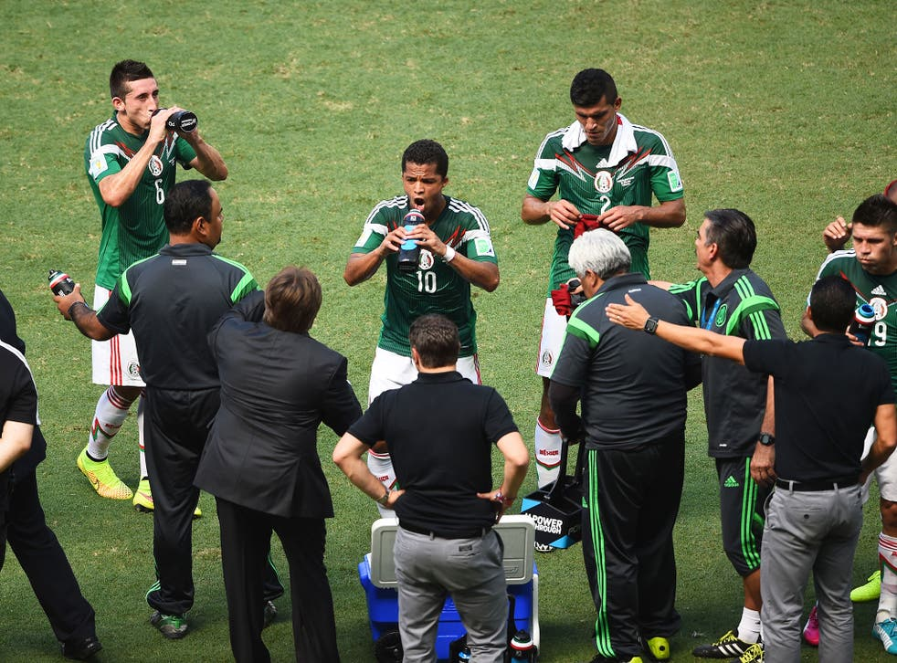 Mexico players take on water during their cooling break