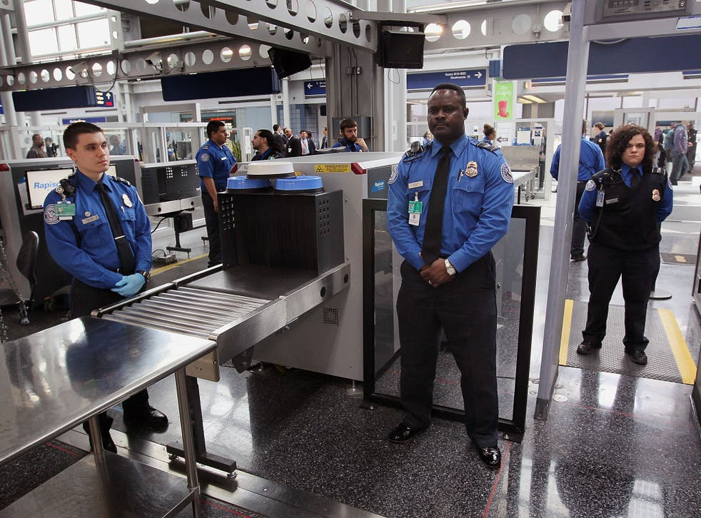 File: Security officers at a checkpoint at O'Hare International Airport in Chicago, Illinois. The US is considering increasing airport security measures in response to a new generation of 'creative' bomb threats from Syrian militant groups
