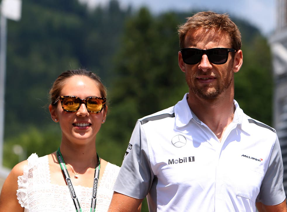 Jenson Button of Great Britain and McLaren arrives in the paddock with his girlfriend Jessica Michibata ahead of the Austrian Formula One Grand Prix