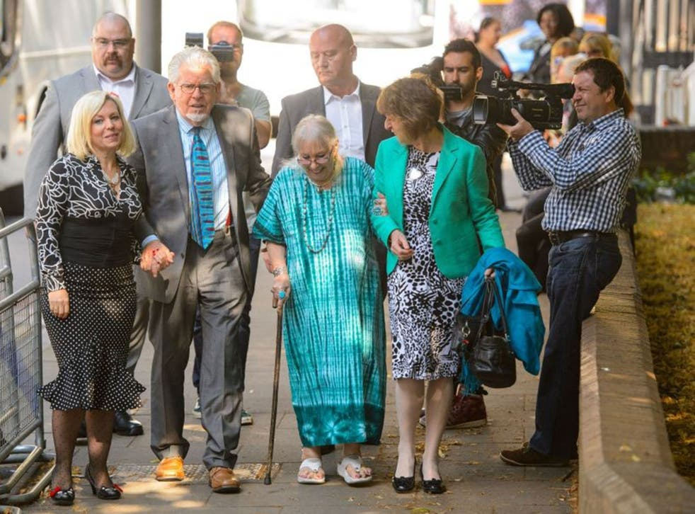 Rolf Harris arriving  with daughter Bindi (left), wife Alwen and niece Jenny at Southwark Crown Court on 30 June 2014. He was convicted of 12 counts of indecent assault between 1968 and 1986