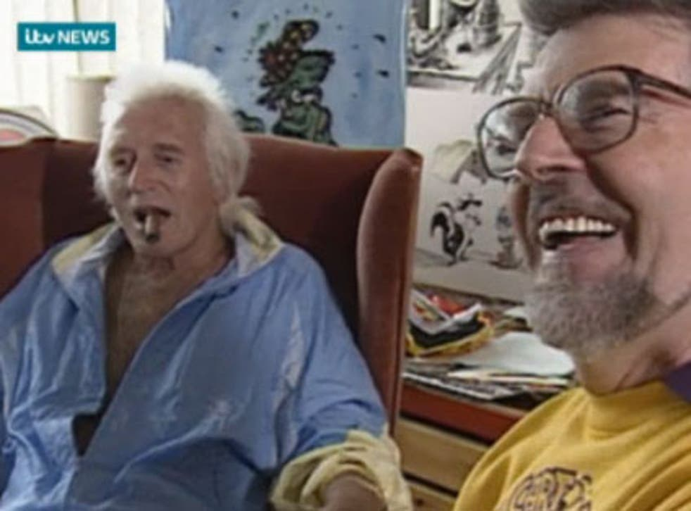 Footage from 1992 shows Rolf Harris drawing a portrait of Jimmy Savile as the pair joke together at ITV West studios in Bristol.