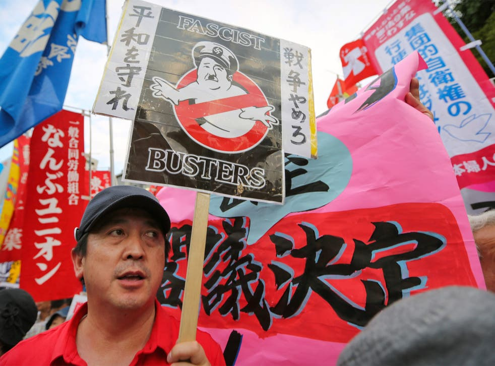 Protesters with anti-war placards hold a mass rally outside the Prime Minister's office in Tokyo