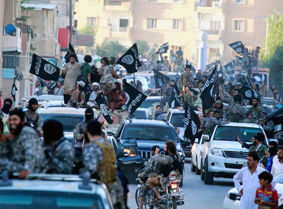 Isis fighters during a parade in Raqqa, Syria