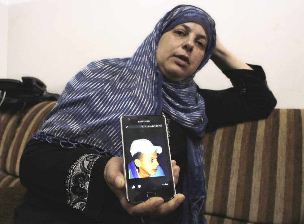 The mother of Mohammed Abu Khdeir shows a picture of her son