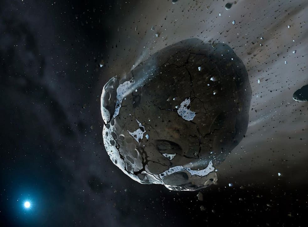 An artist's view of a watery asteroid in white dwarf star system.