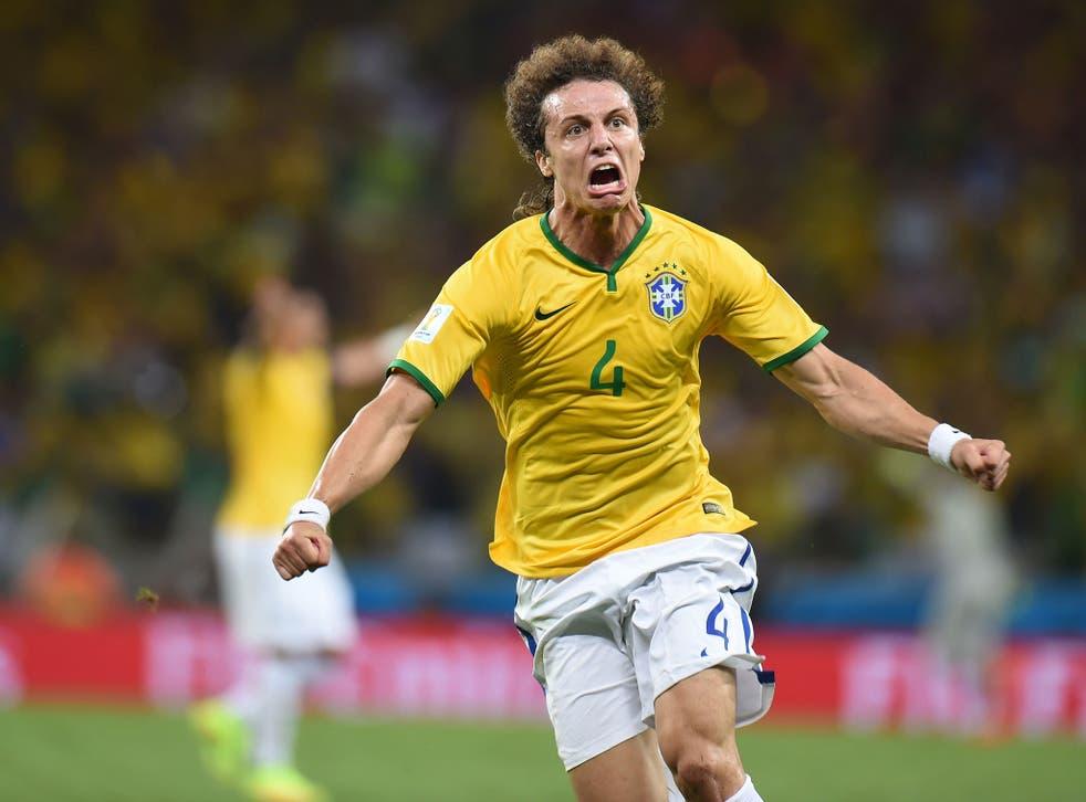 David Luiz celebrates his stunning 35-yard free-kick in Brazil's win against Colombia