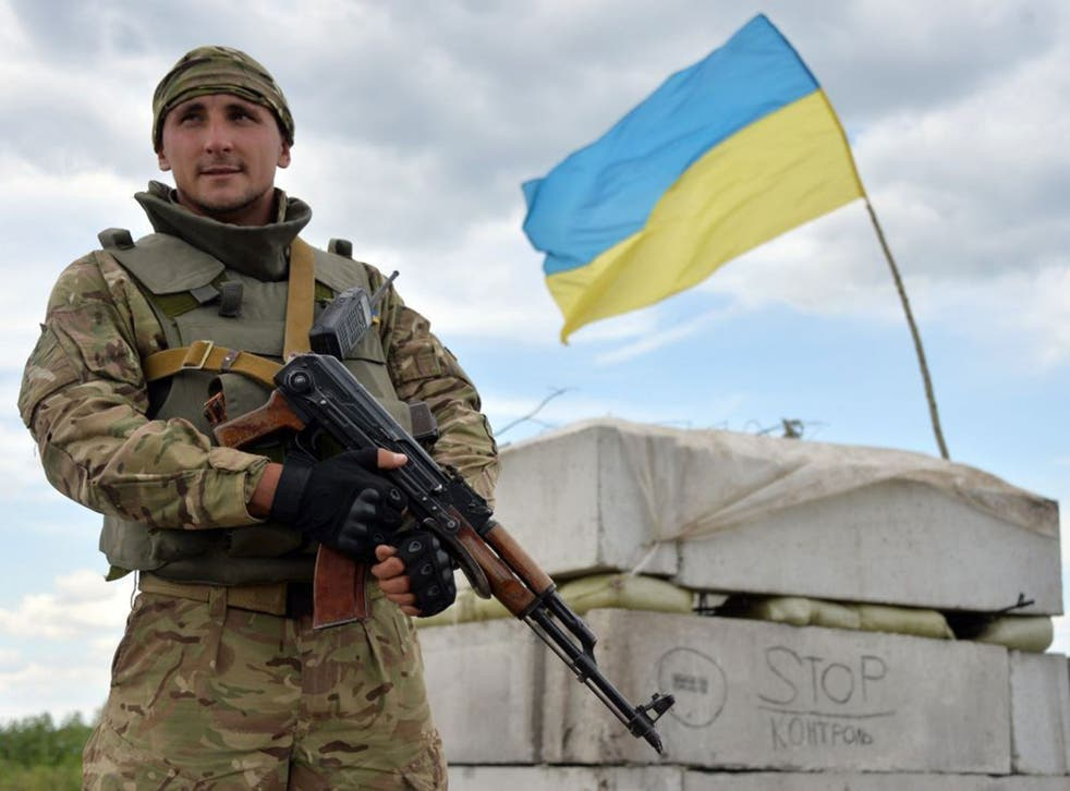 A Ukrainian forces serviceman guards their position at the check-point near  Slavyansk