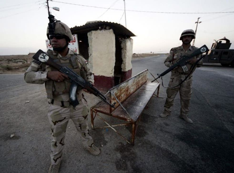 On alert: Iraqi soldiers stationed near the border with Saudi Arabia