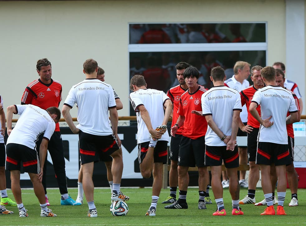 Joachim Low talks to his Germany squad before their semi-final with Brazil