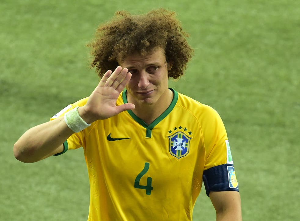 A tearful David Luiz leaves the field