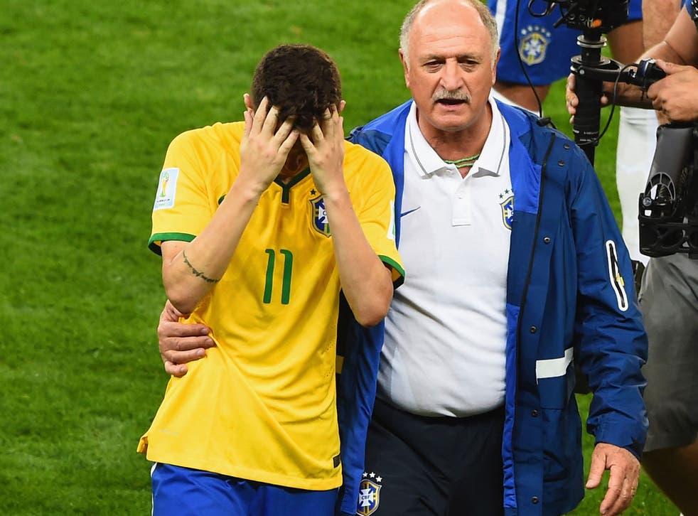 Oscar is consoled by manager Luiz Felipe Scolari
