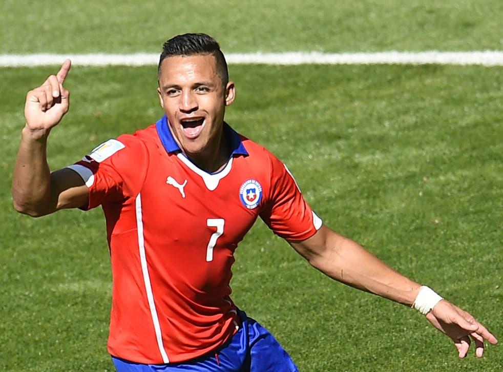Chile forward Alexis Sanchez celebrates scoring against Brazil