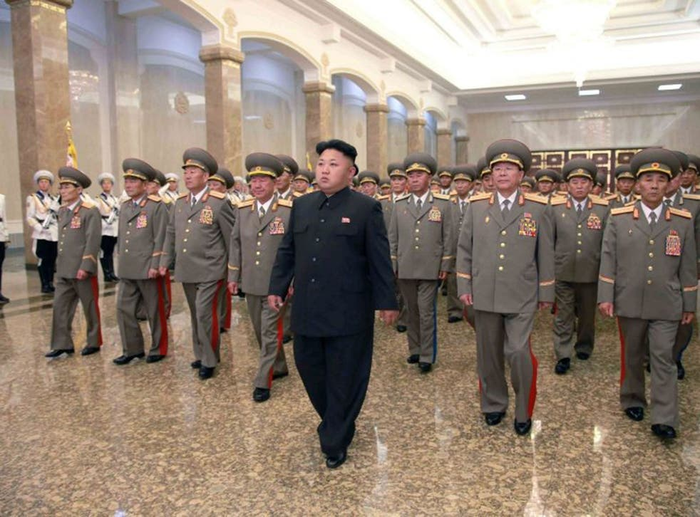 North Korean leader Kim Jong Un (C) visits the Kumsusan Palace of the Sun at midnight on Tuesday on the occasion of the 20th anniversary of the demise of President Kim Il Sung in this photo released by North Korea's Korean Central News Agency (KCNA) in Py