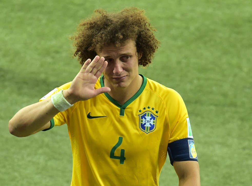 Brazil's defender David Luiz walks off the pitch after losing the semi-final football match between Brazil and Germany at The Mineirao Stadium in Belo Horizonte, during the 2014 FIFA World Cup