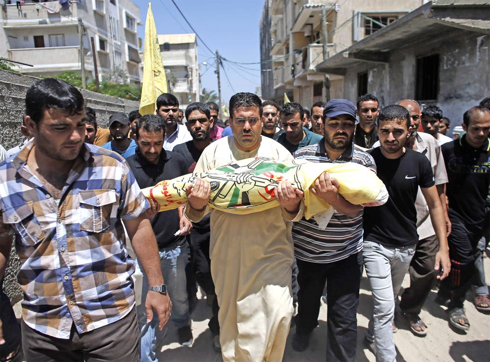 Relatives and friends of the al-Kaware family carry one of the seven members of the family to the mosque during their funeral in Khan Yunis. The father and his six sons were all killed in an Israeli air strike