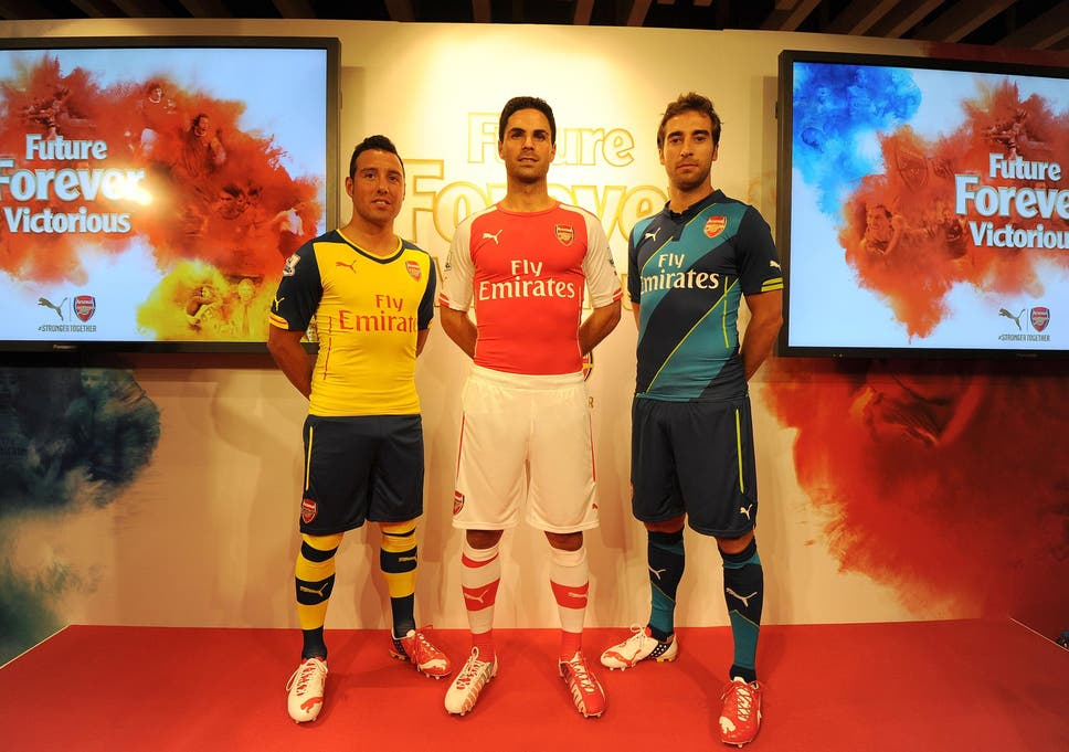 Arsenal kit 2014 15  New Puma shirt unveiled in London  fdeaca207