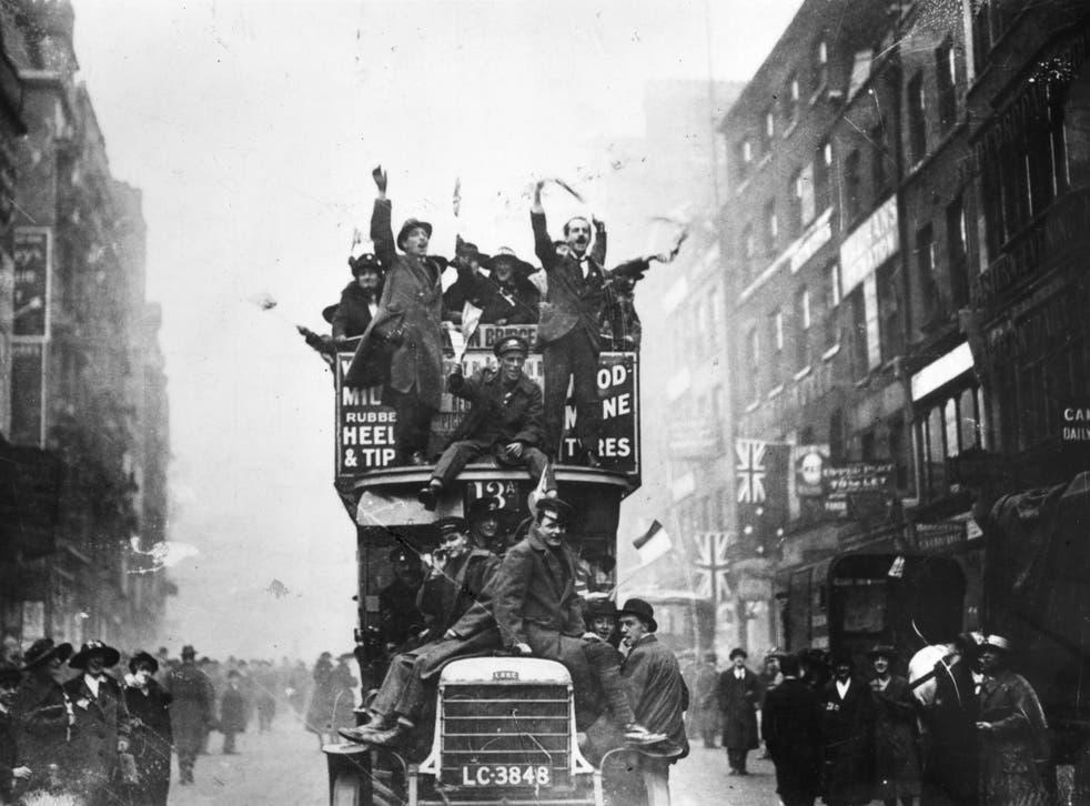 Crowds in London celebrate the end of hostilities in 1918