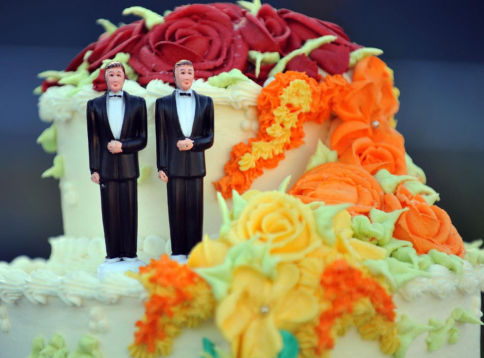 A wedding cake with statuettes of two men is seen during the demonstration