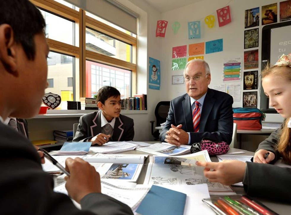 In the hot seat: Sir Michael Wilshaw speaks with pupils at an east London school in 2013