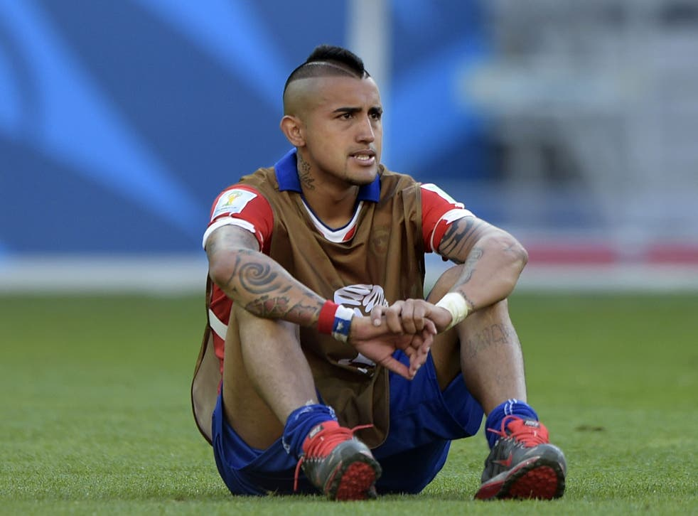 Chile's midfielder Arturo Vidal reacts after losing their match against Brazil in a penalty shoot out after extra-time in the Round of 16 football match between Brazil and Chile
