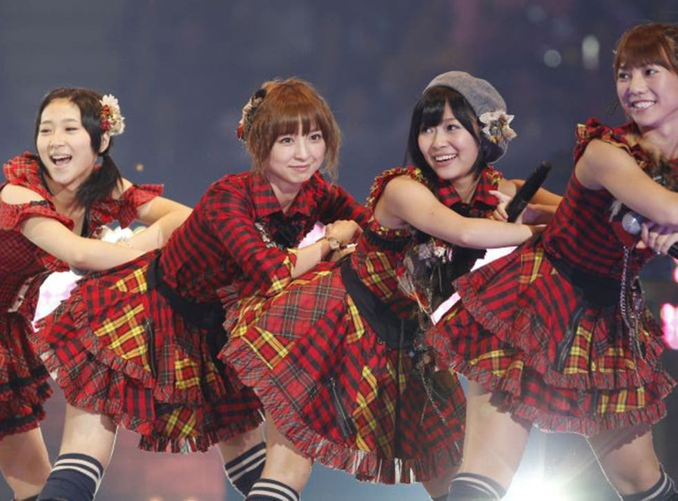 AKB48 perform during one of their daily concerts at Tokyo's Akihabara theatre