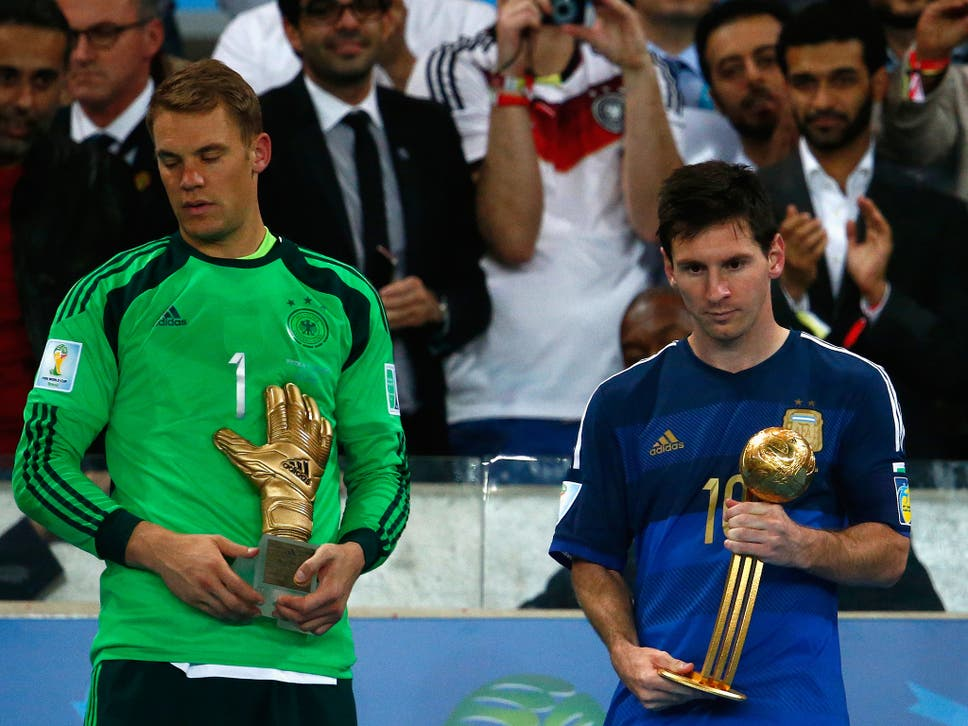 Manuel Neuer Of Germany Holds The Golden Glove Trophy As Lionel Messi Argentina