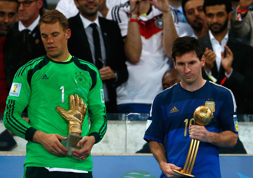 ea414cc7e62 Manuel Neuer of Germany holds the Golden Glove trophy as Lionel Messi of  Argentina holds the