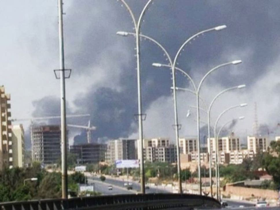 Rival libyan militias clash in battle for tripoli airport the smoke rises from the airport where rebel militias fight publicscrutiny Images