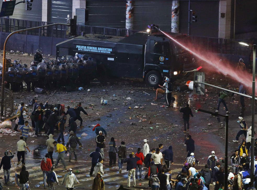 Argentina's fans clash with riot police after Argentina lost to Germany in their 2014 World Cup final in Brazil, at a public square viewing area in Buenos Aires July 13, 2014
