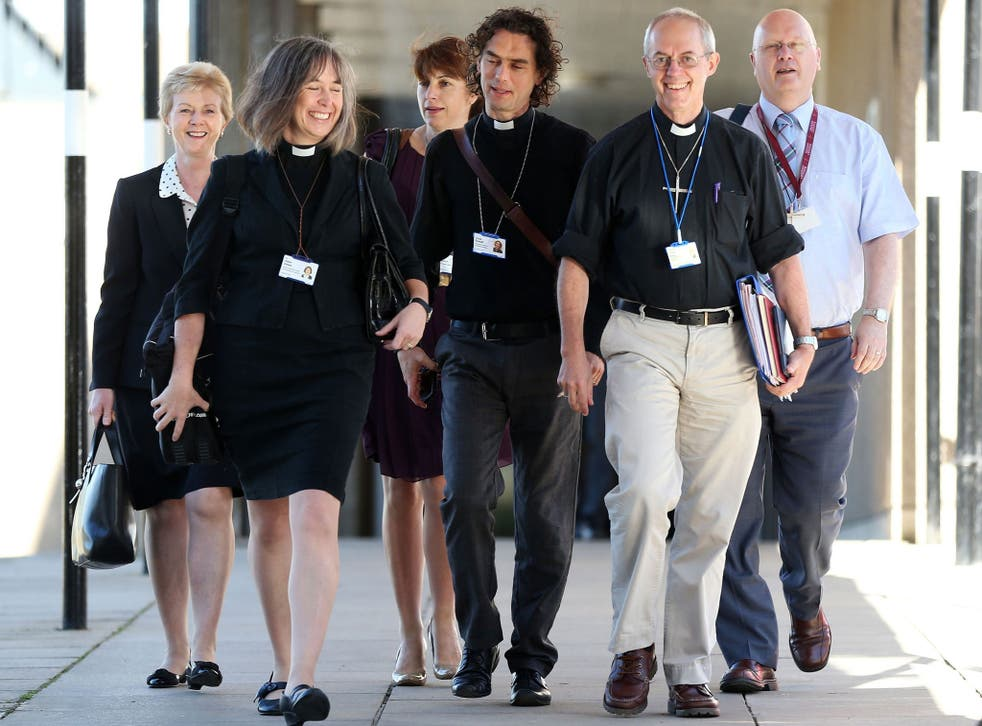The Archbishop of Canterbury, Justin Welby, second right, and members of the clergy arrive for the General Synod meeting at the University of York on Monday 14 July, 2014