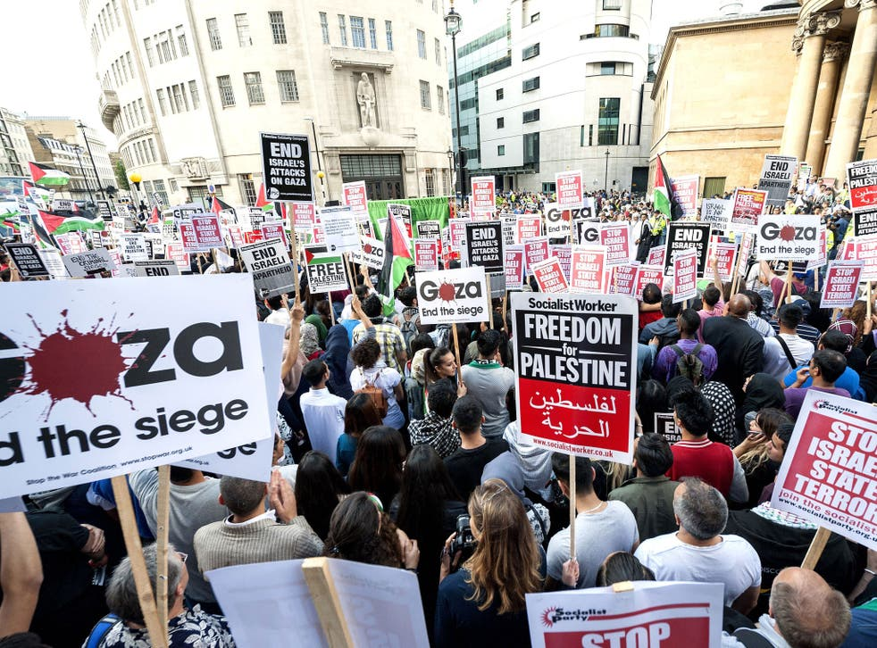 Palestinian and pro-Palestinian demonstrators assemble at the BBC TV Centre in London