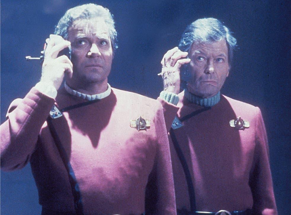 Skype me up, Scotty: Captain Kirk and Dr McCoy use their universal translators in 'Star Trek'