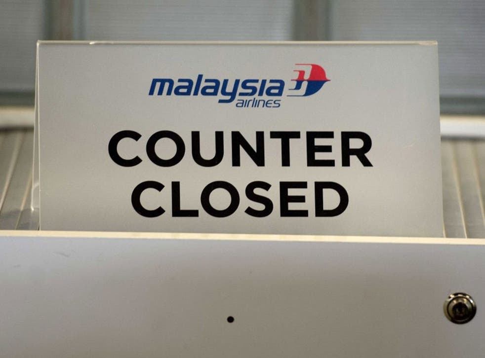 A closed Malaysia Airlines counter at Schiphol airport near Amsterdam