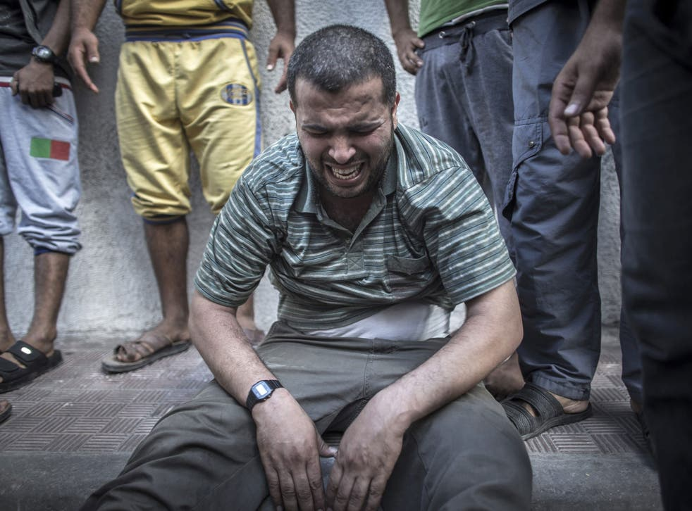 A Palestinian man is left distraught after losing relatives in an air strike
