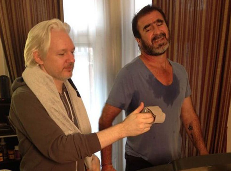 Julian Assange working out with Eric Cantona