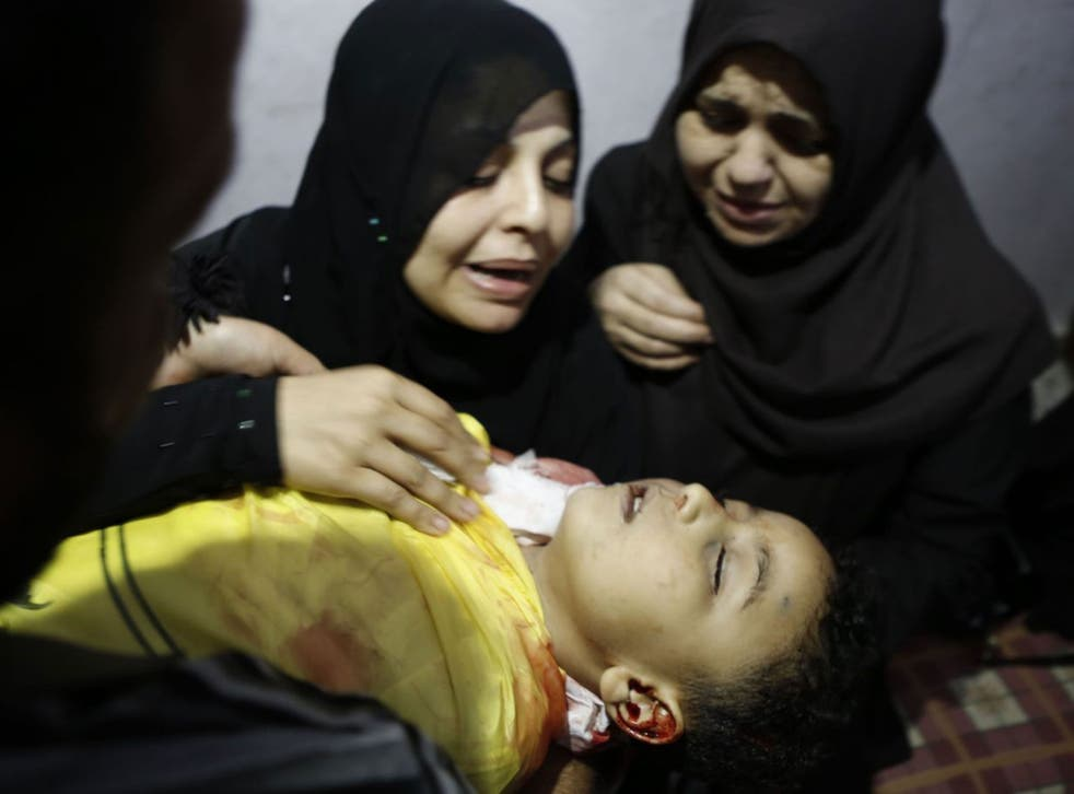Innocents' tears: A mother  yesterday mourns her son killed by an Israeli tank shell in Gaza