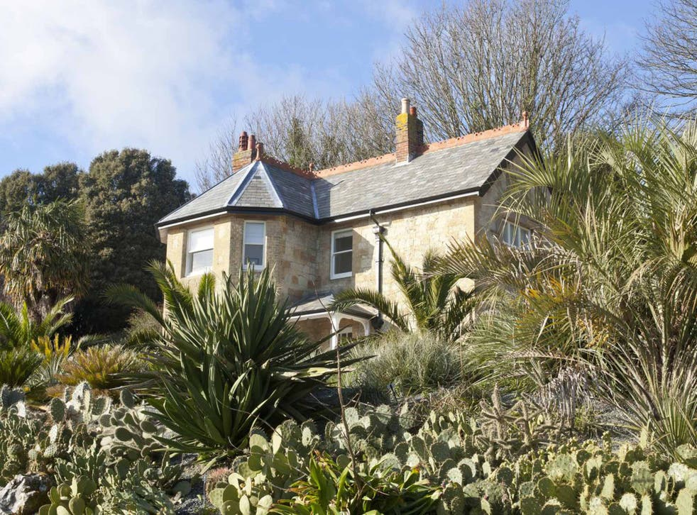 Gardening leave: Signal Point Cottage sits in the Arid Garden