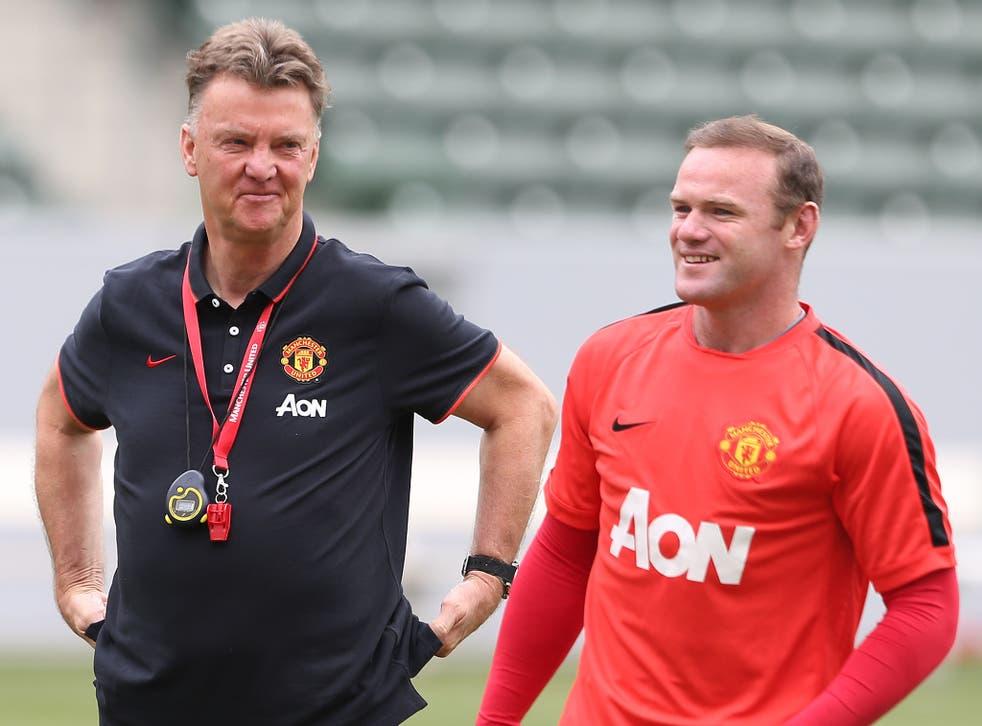 Louis van Gaal works with Wayne Rooney during pre-season