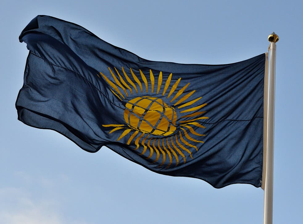 The Commonwealth flag flies outside Westminster Abbey in central London