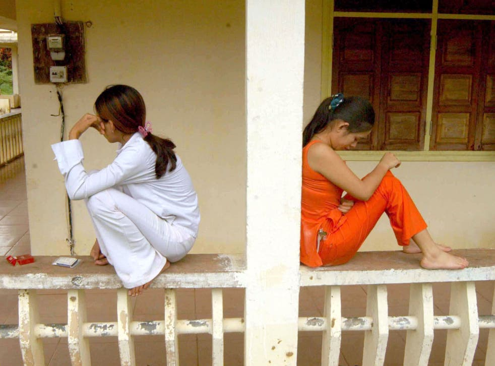 Prostitutes at a clinic in Cambodia wait for the results of  blood tests