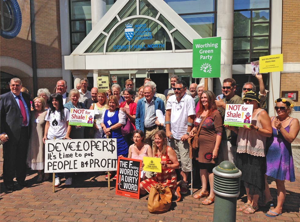 Campaigner celebrate outside West Sussex County Council offices in Horsham after an application by a shale company to explore for oil and gas in a picturesque part of West Sussex has been turned down