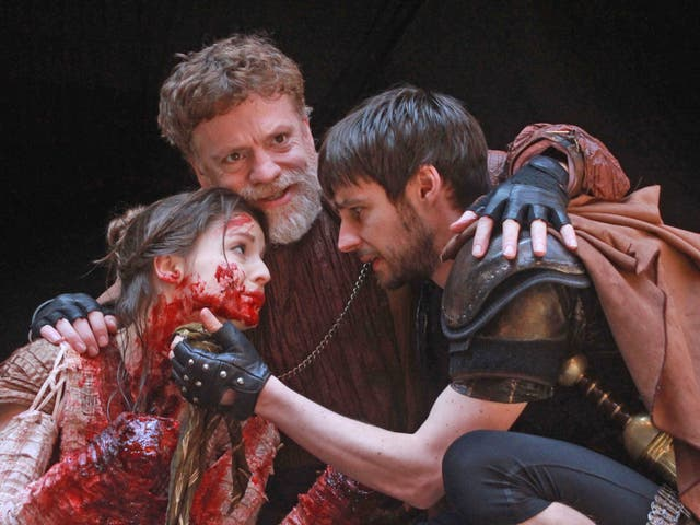 Flora Spencer-Longhurst as Lavinia, William Houston as Titus Andronicus and Dyfan Dwyfor as Lucius