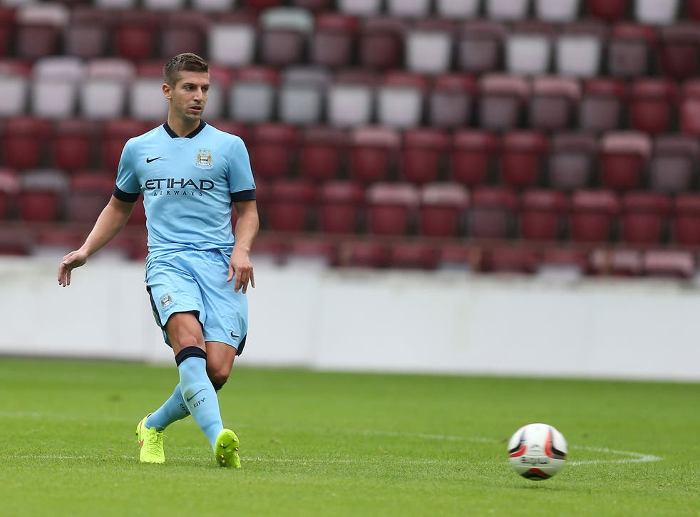 Matija Nastasic playing for Manchester City in a pre-season friendly against Hearts